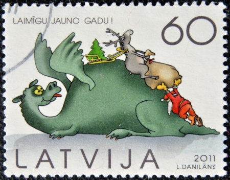 LATVIA - CIRCA 2011: A  stamp printed in Latvia dedicated to Christmas day, circa 2011  photo