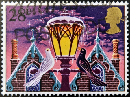 UNITED KINGDOM - CIRCA 1983: A christmas stamp printed in Grat Britain shows 'Light of Christmas' (street lamp), circa 1983 Stock Photo - 16306922