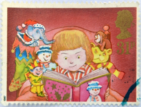 UNITED KINGDOM - CIRCA 1987: A stamp printed in Great Britain dedicated to Christmas, shows Child reading, circa 1987 Stock Photo - 16306909