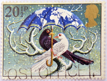 UNITED KINGDOM - CIRCA 1983: A christmas stamp printed in Grat Britain shows 'World at Peace' (Dove and Blackbird), circa 1983 Stock Photo - 16306931