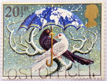 UNITED KINGDOM - CIRCA 1983: A christmas stamp printed in Grat Britain shows 'World at Peace' (Dove and Blackbird), circa 1983 Stock Photo - 16306931