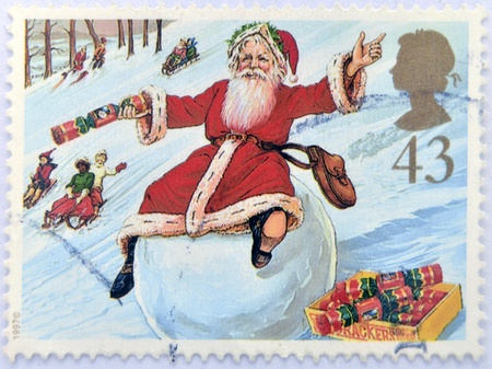 UNITED KINGDOM - CIRCA 1997: A stamp printed in Great Britain shows Father Christmas on Snowball, circa 1997  photo