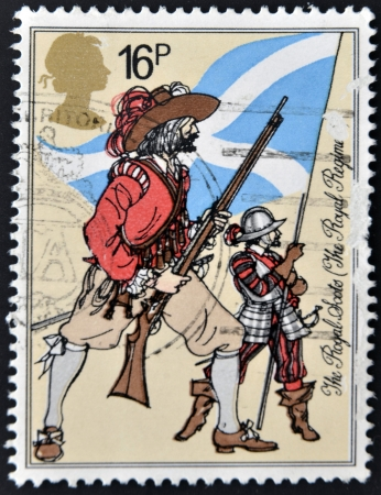 scots: UNITED KINGDOM - CIRCA 1983: A postage stamp printed in Great Britain showing a drawing of The Royal Scots, Royal Regiment, circa 1983.  Stock Photo