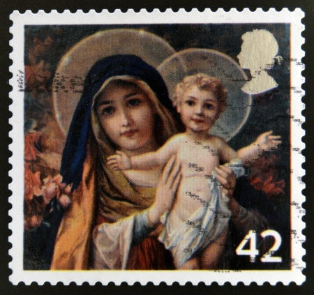 UNITED KINGDOM - CIRCA 2005: A stamp printed in the United Kingdom shows The Virgin mary with Infant Christ, circa 2005  photo