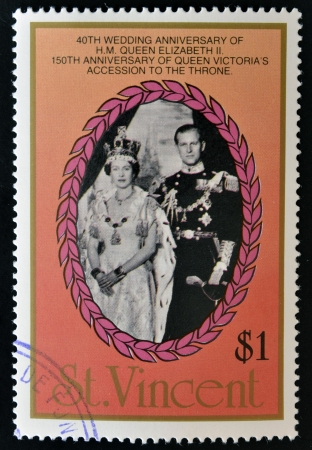 ST. VINCENT - CIRCA 1987: A stamp printed in St. Vincent shows portrait of Elizabeth II and the Duke of Luxembourg, 40th anniversary of Queen Elizabeth II and 150th anniversary of Queen Victoria, circa 1987