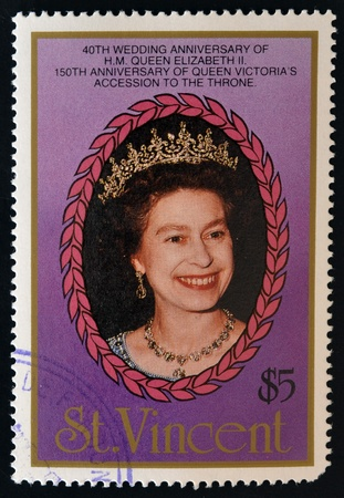 ST. VINCENT - CIRCA 1987: A stamp printed in St. Vincent shows portrait of Queen  Elizabeth II, 40th anniversary of Queen Elizabeth II and 150th anniversary of Queen Victoria, circa 1987