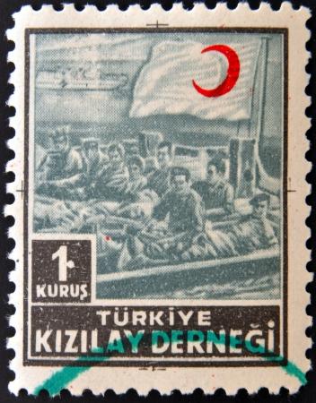 TURKEY- CIRCA 1953: stamp printed in Turkey shows red crescent, circa 1953  photo