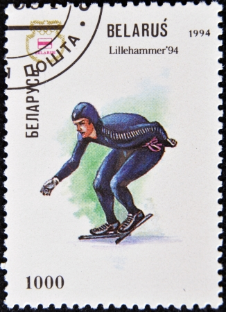 olympics: BELARUS - CIRCA 1994  A stamp printed in Belarus shows a a speed skater at the Olympics in Lillehammer in 1994, circa 1994