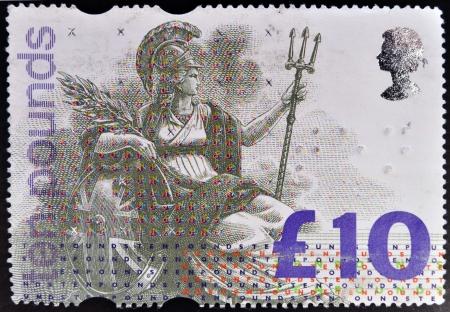 britannia: UNITED KINGDOM - CIRCA 1993: A stamp printed in Great Britain dedicated to High Value Definitive shows Britannia, personification of England, circa 1993