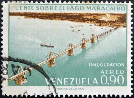 VENEZUELA - CIRCA 1962: A stamp printed in Venezuela shows inauguration of the bridge over Lake Maracaibo, circa 1962 photo