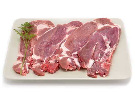 raw pork chops with parsley photo