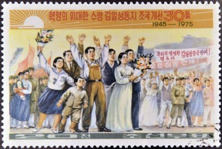 NORTH KOREA - CIRCA 1975: A stamp printed in Korea shows people celebrating the anniversary of the founding of North Korea in 1945, circa 1975