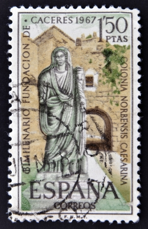 matron: SPAIN-CIRCA 1967: A stamp printed in Spain shows a picture of a Roman matron and the Arc of Christ, two thousandth anniversary of the founding of the Romans Caceres, circa 1967.