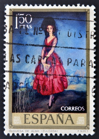 ignacio: SPAIN-CIRCA 1971: A stamp printed in Spain shows a painting of the Duchess of Alba with mantilla and red dress by Ignacio Zuloaga, circa 1971.