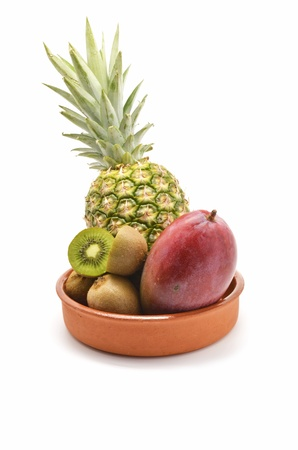 Tropical fruits: pineapple, kiwi and mango photo
