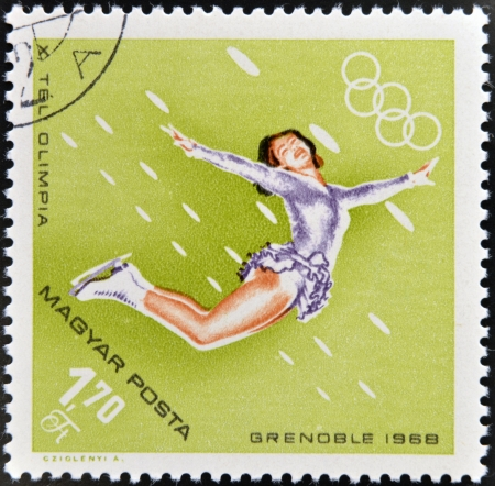 HUNGARY - CIRCA 1968: A stamps printed in Hungary showing an athlete in figure skating,Winter Olympic sports in Grenoble 1968, circa 1968