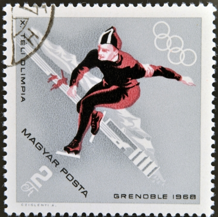 HUNGARY - CIRCA 1968: A stamps printed in Hungary showing an athletes speed skating,Winter Olympic sports in Grenoble 1968, circa 1968
