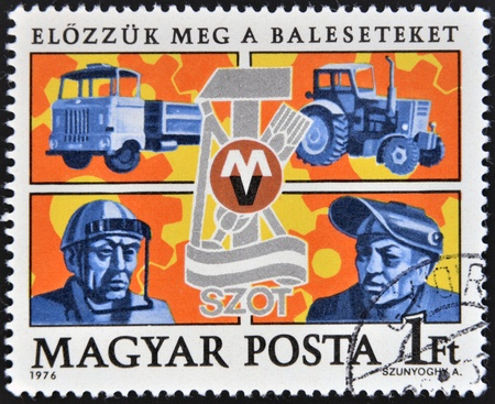 safety slogan: HUNGARY - CIRCA 1976: stamp printed in Hungary shows Trucks, Safety Devices, Trade Union emblem, circa 1976