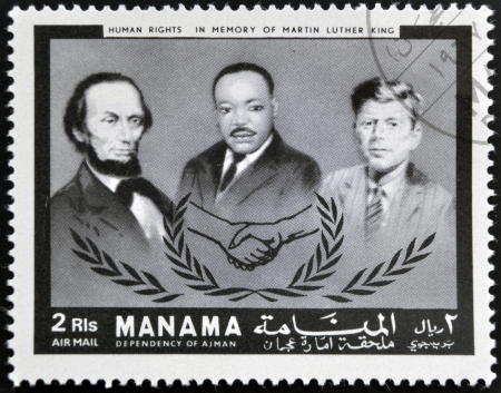 AJMAN - CIRCA 1974: Stamp printed in Ajman in memory of Martin Luther King, Human Rights, circa 1974 Stock Photo - 16961376