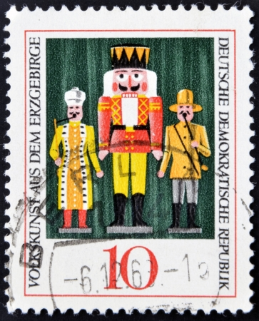 DEMOCRATIC REPUBLIC OF GERMANY - CIRCA 1967: A stamp printed in Germany dedicated to Folk art from the Erzgebirge mountains, shows the Nutcracker, circa 1967 Stock Photo - 16958989