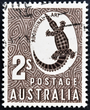"AUSTRALIA - CIRCA 1948: A stamp printed in Australia shows a Crocodile with the inscription ""Aboriginal Art"", circa 1948"