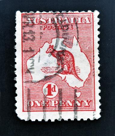 AUSTRALIA - CIRCA 1913: stamp printed in Australia shows kangaroo in the map, one penny, circa 1913