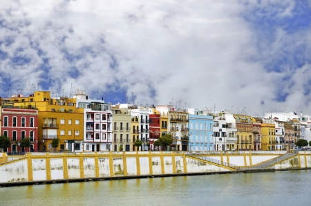 Famous Betis street in Triana district of Seville with Guadalquivir river at the foot photo