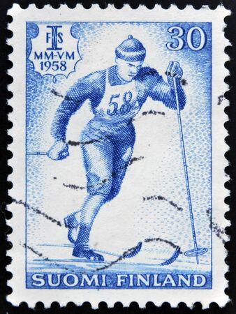 nordic ski: FINLAND - CIRCA 1958: A stamp printed in Finland shows Nordic ski, circa 1958  Stock Photo