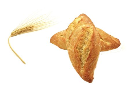 Two loaves of bread and wheat spike photo