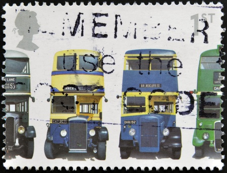 rt: UNITED KINGDOM - CIRCA 2001: A stamp printed in Great Britain shows AEC Regent 1, Daimler COG5, Utility Guy Arab Mk II and AEC Regent III RT Type, circa 2001