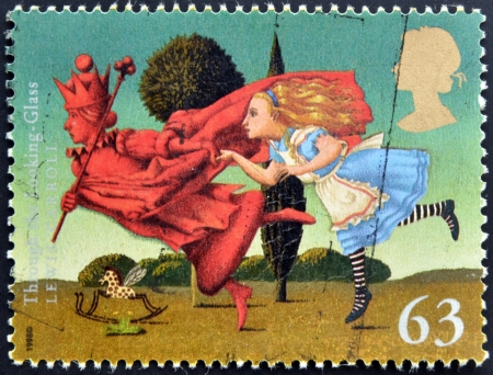 lewis carroll: UNITED KINGDOM - CIRCA 1988: A stamp printed in Great Britain shows Through The Looking Glass (Lewis Carroll), circa 1988  Editorial