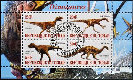 deinonychus: CHAD - CIRCA 2010: Stamps printed in Chad shows dinosaurs, circa 2010  Stock Photo