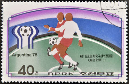 NORTH KOREA - CIRCA 1978: a stamp printed in North Korea shows football players. World football cup in Argentina, circa 1978  photo