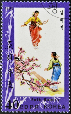 NORTH KOREA - CIRCA 1983: A stamp printed in DPR Korea dedicates to folk games, circa 1983