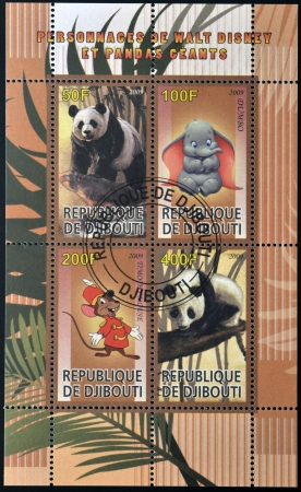 DJIBOUTI - CIRCA 2009: stamps printed in Djibouti dedicated to the characters of Walt Disney and giant pandas, circa 2009