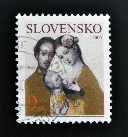 SLOVAKIA - CIRCA 2005: A stamp printed in Slovakia dedicated to family, circa 2005 Stock Photo - 17145086