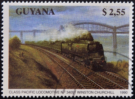 GUYANA - CIRCA 1990: A stamp printed in Guyana shows class pacific locomotive nº 34051 Winston Churchill, circa 1990  photo