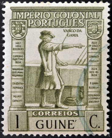 PORTUGAL - CIRCA 1932: A stamp printed in Portugal with underprint Guinea shows Vasco Da Gama, circa 1932  photo