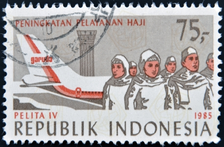 pelita: INDONESIA - CIRCA 1985: Stamp printed in Indonesia dedicated to Fourth Development Cabinet, Pelita IV, shows plane and people, circa 1985