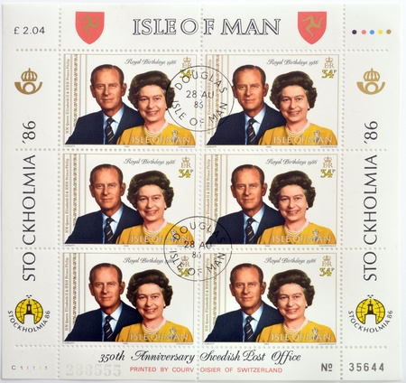 ISLE OF MAN - CIRCA 1986: Stamps printed in Isle of Man shows queen Elizabeth II and Prince Philip, circa 1986