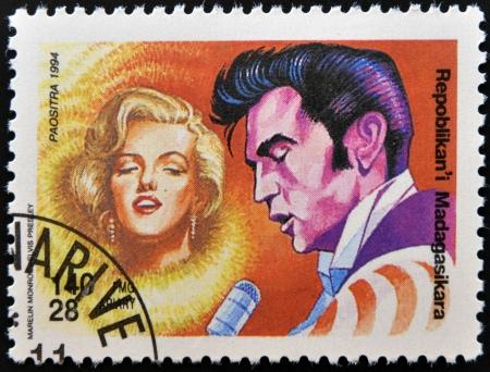 marilyn monroe: MADAGASCAR - CIRCA 1994: A stamp printed in Madagascar shows Marilyn Monroe and  Elvis Presley, circa 1994  Editorial