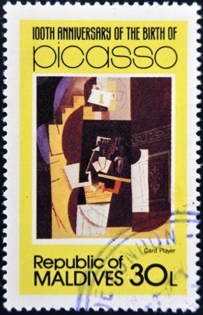 card player: MALDIVE ISLANDS - CIRCA 1981: stamp printed in Malldives Islands shows card player by Pablo Ruiz Picasso, circa 1981 Stock Photo
