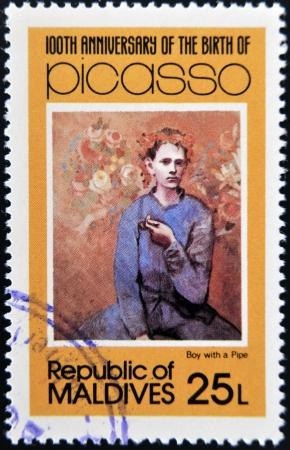 pablo: ISOLE MALDIVE - CIRCA 1981: timbro stampato in Malldives Isole mostra ragazzo con la pipa di Pablo Ruiz Picasso, circa 1981