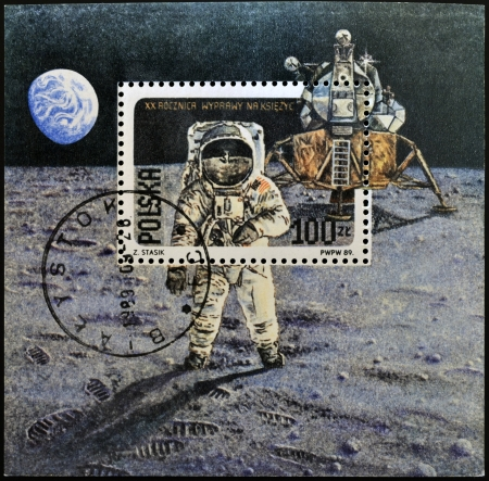 POLAND - CIRCA 1989: A stamp printed in Poland shows Neil Armstrong, lunar module Eagle from Apollo 11, circa 1989 photo