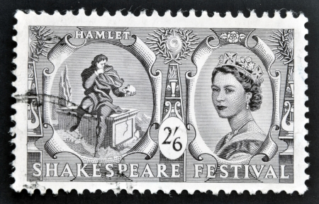 UNITED KINGDOM - CIRCA 1964: A stamp printed in Great Britain dedicated to Shakespeare Festival, shows Hamlet contemplating Yoricks skull (Hamlet) and Queen Elizabeth II, circa 1964
