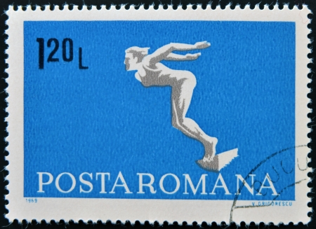 ROMANIA - CIRCA 1969: A stamp printed in Romania shows diving swimmer, circa 1969 Stock Photo - 17139507