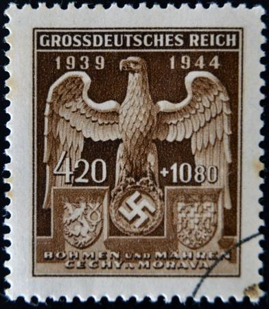 swastika: GERMAN REICH - CIRCA 1944: A stamp printed Germany shows eagle and swastika, circa 1944