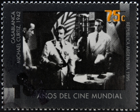 ARGENTINA - CIRCA 1995: A stamp printed in Argentina dedicated to 100 years of world cinema shows Casablanca scene of Michael Curtiz, circa 1995
