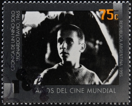 chronicle: ARGENTINA - CIRCA 1995: A stamp printed in Argentina dedicated to 100 years of world cinema shows scene of Chronicle of a Boy Alone by Leonardo Favio, circa 1995