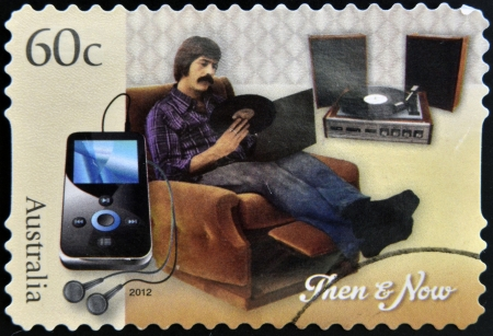 then: AUSTRALIA - CIRCA 2012: A stamp printed in Australia dedicated to Technology - Then and Now, circa 2012